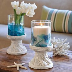 Stone pedestal pillar candle holder filled with sea glass. Where to buy sea glass: http://www.completely-coastal.com/2012/10/where-to-buy-sea-glass-for-crafting-and-jewelry-making.html 10 Pillar Candle Holder Display Ideas: http://www.completely-coastal.com/2012/11/pillar-candle-holders-display-ideas-coastal-and-beach.html
