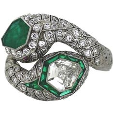 Double Snake Head Emerald Diamond Platinum Ring | See more rare vintage Fashion Rings at https://www.1stdibs.com/jewelry/rings/fashion-rings