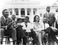 Selma to Montgomery Civil Rights March, 1965: Dr. Martin Luther King, Jr. with his wife Coretta Scott King.  Seated next to Dr. King is Ralph Abernathy. Next to Mrs. King is John Lewis;  to his right, A. Philip Randolph, leader of the Brotherhood of Sleeping Car Porters and Bayard Rustin. From the Jack T. Franklin Photography