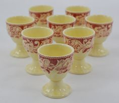 One of my favorite patterns is Pomeroy by Royal Doulton. This lovely egg cup is a vintage red transferware piece dating to about the 1930's. The border is a mix of fruits and flowers intertwined with