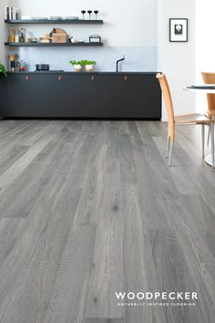 Harlech Stormy Oak is a dreamy fusion of grey hues and whitened grains. Careful brushing brings the wood's beautifully natural textures to the fore. Get a free sample. Karndean Flooring, Grey Flooring, Flooring Ideas, Living Room Flooring, Kitchen Flooring, Grey Wooden Floor, Wood Floor Stain Colors, Grey Kitchen Floor, Grey Bedroom With Pop Of Color