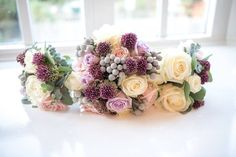 Bride and Bridesmaid's Bouquets at Northbrook Park by Fiona Curry Flowers.