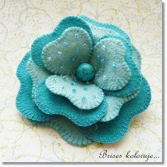 blanket stitched felt flower.