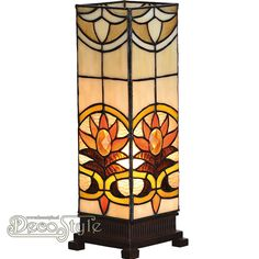 Tiffany Windlicht Xania Deluxe Small Een bijzonder mooi windlicht. Helemaal met de hand gemaakt van echt Tiffanyglas. Dit originele glas zorgt voor de warme uitstraling. De voet is vervaardigd van brons. Met 1x kleine fitting (E14). Met schakelaar in het lichtnetsnoer. Afmetingen: Hoogte: 36 cm Breedte: 12,5 cm Diepte: 12,5 cm