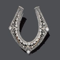 An early 20th century diamond brooch, circa 1910 Designed as a stylised horseshoe, pierced and millegrain set throughout with old brilliant, single and rose-cut diamonds, diamonds approx. 2.00ct. total, brooch and clip fitting, formerly part of a hair ornament, length 4.8cm., fitted case