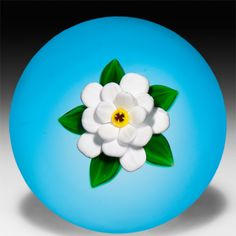 Bobby Banford single white flower on translucent blue ground paperweight.