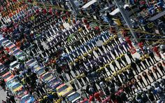 Cars, drivers and pit crews lined up on Pit Road during Pre-Race ceremonies