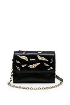 The Lips Micro Mini is all you need for a night out.  Fits your smartphone, keys, a credit card and lipstick. Featuring a chain link and leather strap, interior open pocket and exterior back pocket.  In leather with lip embellishments.