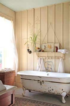 An old footed tub, updated with new fittings, is situated to take in a view of the Texas Hill Country.