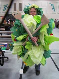 Tossed Salad Halloween Costume - won 2nd place in contest. Card board box, with Tissue paper for the lettuce, cut out of felt tomatoes, carrot shreds, cheese. Used paper towel rolls for the fork and spoon, cardboard and cut the shapes, clear tape to make them stick together. Stocking cap with bobby pins for the salad on her head,