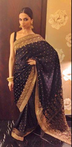"Deepika Padukone in black saree Diwali bash 2015. The ""Tamasha"" heroine looks gorgeous in black Sabysachi embroidery saree paired with sleeveless blouse."