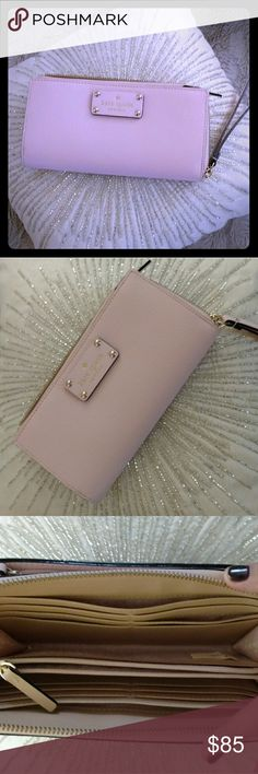 New Kate Spade Layton Wellesley wristlet Wallet Never used light pink Kate Spade Layton Wellesley Wristlet very spacious room for phone etc. 12 credit card slots two zip slots. kate spade Other