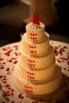 A gorgeous Chinese Wedding Cake decorated in traditional red.