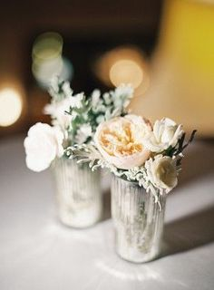 Pale peach and white flowers in mercury glass vases