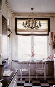 old french cafe.  I have this dream of decorating my kitchen with elements of French cafe style.