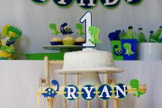 DinoROAR party package by Pinwheel Lane on etsy -- Dinosaur Highchair banner and smash cake topper