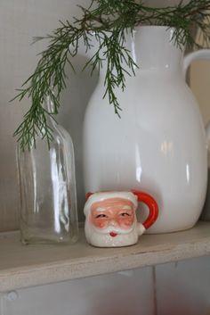 santa mug, white pitcher, clear glass, greenery