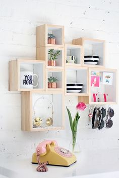 If anything is going to help me (finally!) keep track of my keys, wallet, and sunglasses, I have a feeling this cubist organizer is it. Store-bought unfinished wood boxes make this shelving unit remarkably inexpensive and easy to assemble. Out-the-Door Box Storage, from I Spy DIY.