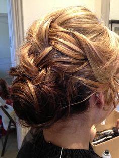 Loose french braid into low chignon bun