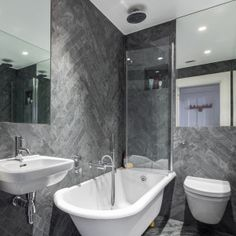 Creating a relaxing space in a small bathroom can be tricky, but bathroom design experts and new lines of compact sanitaryware have got you covered. Here we explain how to make a small bathroom feel much bigger Grey Bathroom Tiles, Brown Bathroom, Grey Bathrooms, Master Bathroom, Mint Bathroom, Bathroom Wall, Shower Bathroom, Grey Tiles, Bathroom Mirrors