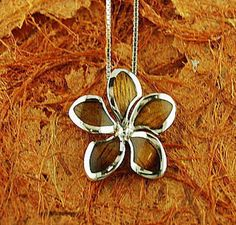 Hey, I found this really awesome Etsy listing at https://www.etsy.com/listing/233578778/sterling-silver-koa-wood-23-mm-plumeria