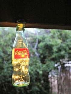 How to make pretty Coke bottle Luminarias using a floral light strand! AND a bonus wish bottle tutorial, too!