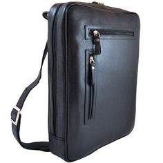 Leather.  Accommodates a 15.4-inch laptop.  Two spacious compartments, including dedicated computer compartment.  Center divider features a full-size zipper pocket.  Key clip in front compartment.  Separate, spacious leather pockets in front compartment to accommodate: Cell phone, Lipstick, A bundle of business cards and Two, large barrel designer pens, Media Player/PDA/agenda.