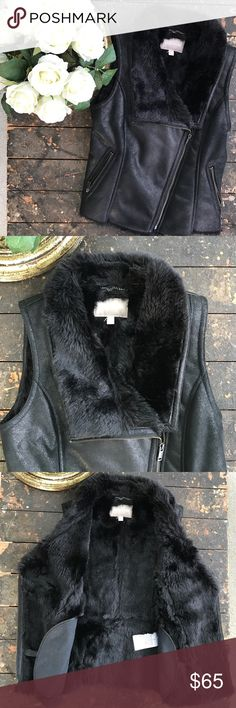NWOT Banana Republic Vest Gorgeous black vest, the outside feels looks like leather and feels like a soft leather and the inside is faux fur, two pockets on the outside, asymmetrically placed zipper; this vest is stunning! Banana Republic Jackets & Coats Vests