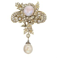 AN ATTRACTIVE ANTIQUE NATURAL PEARL AND DIAMOND PENDENT BROOCH  Of floral design, the pinkish button-pearl pearl measuring 16.10 by 10.90 mm and weighing 80 grains (20.0 carats) mounted en tremblant to the old-cut diamond scrolling spray suspending a drilled pearl drop measuring 16.20 by 13.77 mm and weighing 75.68 grains (18.92 carats), 7.5 cm long, circa 1890.