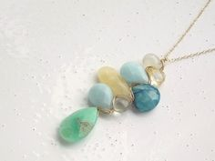 Citrine, Amazonite, Calcite, African Azurite, Green Amethyst, and Chrysophase Woven Pendant Necklace. $44.80, via Etsy.