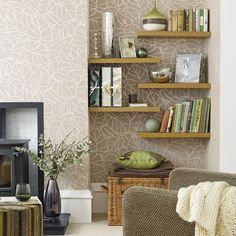 "an idea how to decorate ""wall alcove"" ""wall niche""...or even ""tv alcove"" . cute stencil or wall paper backing and staggered floating shelves"