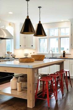 Windows by stove, above sink red metal counter stools. White shaker perimeter cabinets are contrasted with a black countertop holding a sink with a polished nickel gooseneck faucet beneath a bank of windows. Wooden Kitchen, Diy Kitchen, Kitchen Dining, Kitchen Decor, Cheap Kitchen, Kitchen Island, Decorating Kitchen, Kitchen Stools, Deco Design