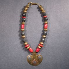 """Coral, Onyx, + Brass – stones glass + bones  """"Ethiopian brass saucers, natural unpolished Onyx, Coral, + vintage brass/ silver/ copper Tuareg pendant from Mali- 1920's, 2.5"""" x 3"""""""