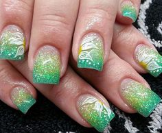 Colorful glitter polish Ombre nail art. You can also make use of glitter polish for your Ombre nail art combination. Add flower details on top to make the background jump out of your nails.