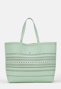 Hit the sand and sun with this beach friendly tote. Teo features perforated details and dual top handles. Pack your shades and hit the beach!...