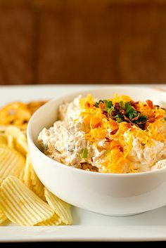 Loaded Baked Potato Dip 16 ounces sour cream package bacon, cooked and crumbled 8 ounces sharp cheddar cheese, shredded cup thinly sliced scallions or chives Combine & refrigerate one hour together. Garnish with extra shredded cheese, crumbled bacon. Baked Potato Dip, Loaded Baked Potatoes, Loaded Potato, Potato Food, I Love Food, Good Food, Yummy Food, Antipasto, Yummy Appetizers