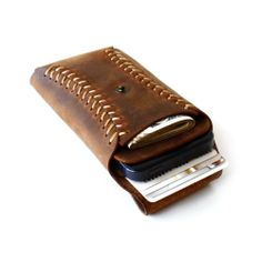 iPhone Leather Wallet featuring a baseball style stitch.Perfect for baseball fans!