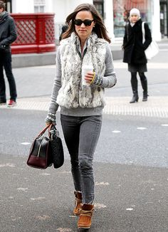 Pippa Middleton rocked a fur vest over a gray sweater, French Connection skinny jeans and patterned fingerless gloves on her way to work in London.