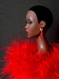 This doll is giving me EVERYTHING. I remember trying to cut my barbie's hair into a small fro, and her scalp was just plugs! I was so sad! Glad times have changed!