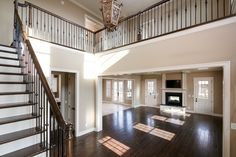 Open floor plan featuring Italianate interior design selections. Designed and built by Ramage Company.