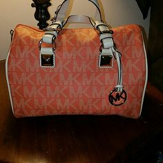 Authentic Michael Kors tangerine grayson. This color in this bag is EXTREMELY hard to find!! Its a beautiful bag for Fall!!           $298