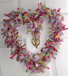 DIY Heart Tied Wreath...using a grapevine wreath and strips of fabric.  So perfect to hang on your door for Valentine's Day and the month of February...how to included.