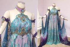 We created this gown for our customer Elizabeth to wear to the Labyrinth Masquerade Ball! Intricate sequin mesh overlays purple silk. The collar and under bust belt are decorated with teal jewels a...