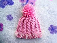 Ravelry: Pink Cabled Baby Hat pattern by Christy Hills