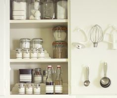 Baking Pantry in a Cabinet. I love how the mixer attachments are hung!