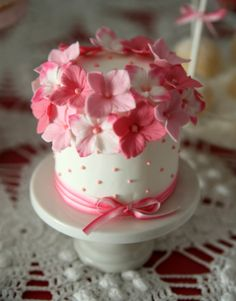 cute mini cake covered in pink flowers