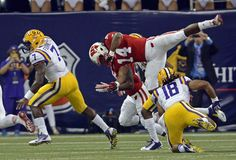 Advocate staff photo by BILL FEIG -- LSU freshman running back Leonard Fournette, left, takes advantage of Terrence Magee's block on Wiscons...
