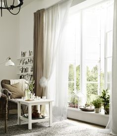 Layer a sheer set of curtains and a heavier set, so you can use one to let in light and the other to help insulate your windows. From IKEA, LILL sheer curtains and VIVAN  beige curtains.