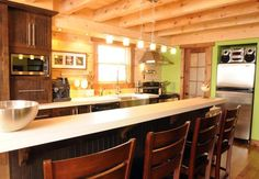 Contemporary log home kitchen with lime green walls