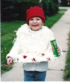 A child dressed as spaghetti and meatballs.